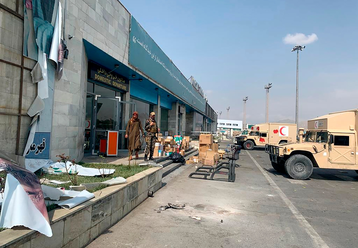 The Taliban are in full control of Kabul's international airport after the last US plane left its runway, marking the end of America's longest war. [Kathy Gannon/AP Photo]