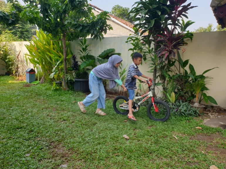 Aisyah plays with her foster brother Jessica Washington A new generation of orphans as COVID ravages Indonesia | Child Rights News