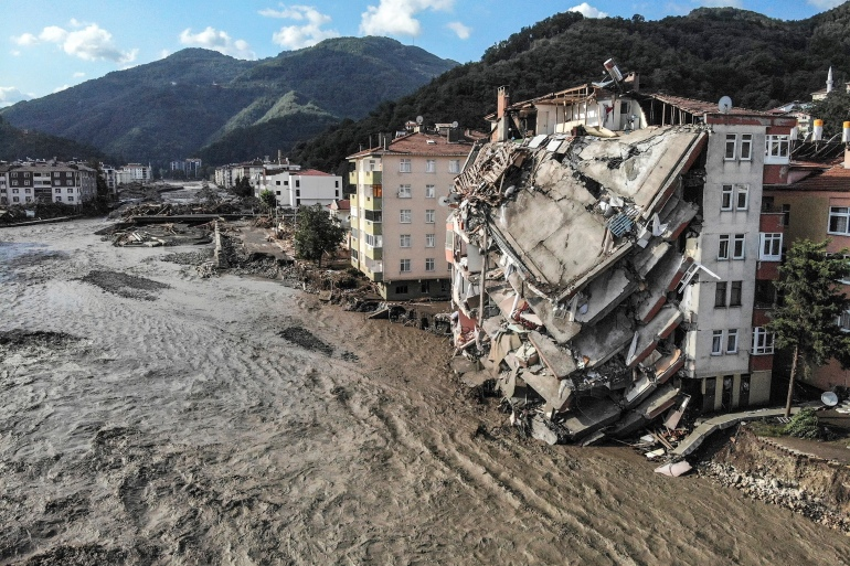 An aerial photo shows destroyed buildings after floods and mudslides in Bozkurt [Ismail Coskun/IHA via AP]