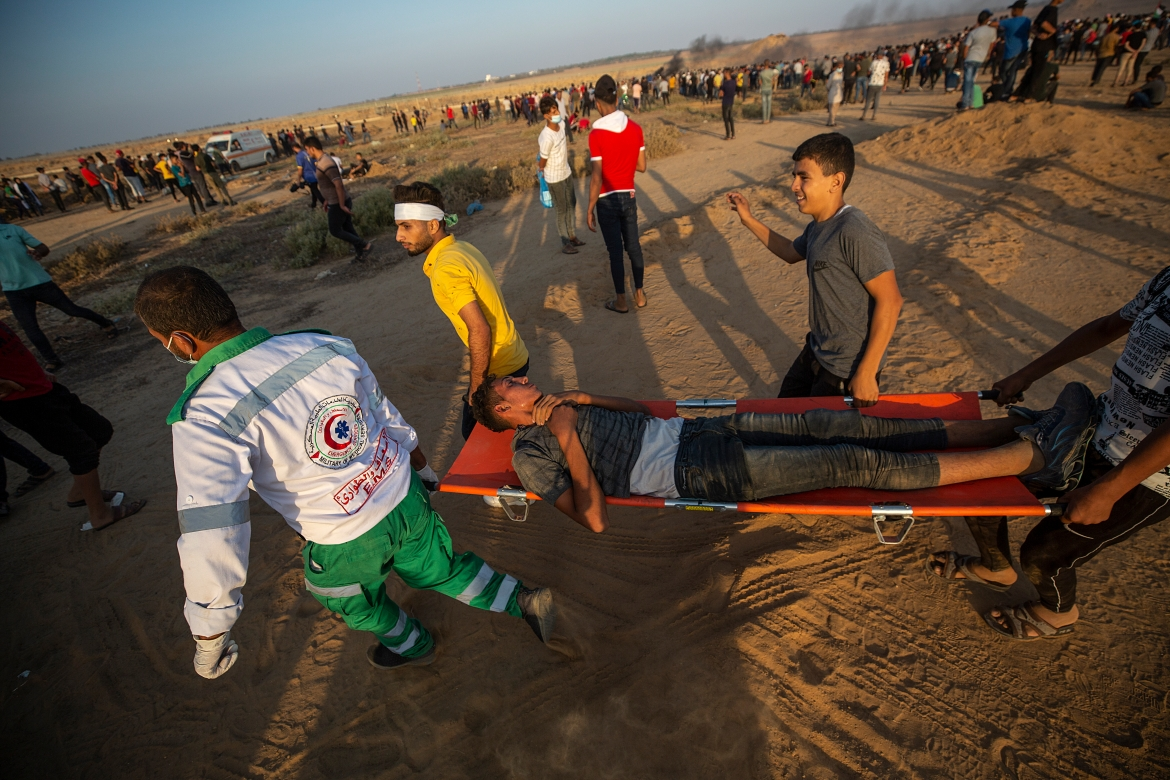 Palestinian medics reported at least 14 people were wounded, including five people who were shot. [Mohammed Saber/EPA]
