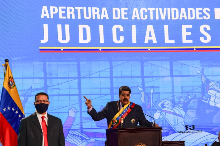 Venezuelan President Nicolas Maduro delivers a speech next to a bodyguard during opening ceremony of the judicial year at the Supreme Tribunal of Justice building in Caracas [File: Yuri Cortez/AFP]