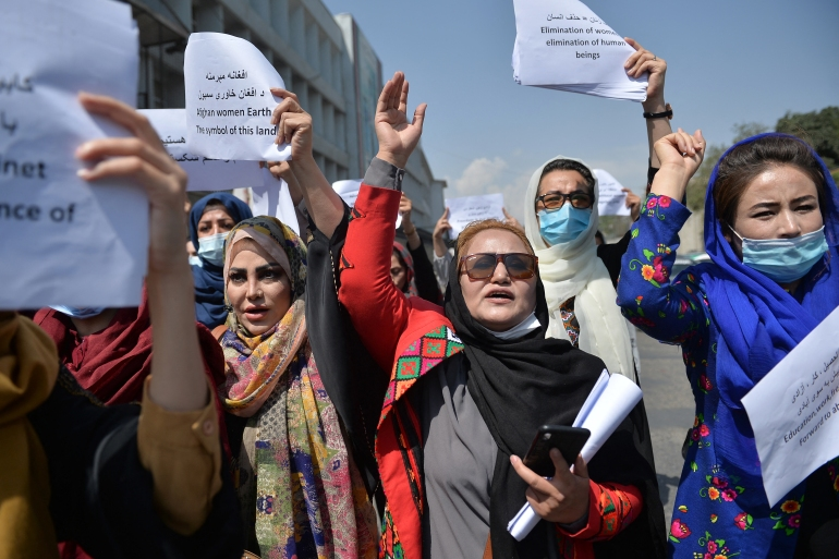 Afghan women take part in a protest march for their rights under the Taliban rule in the downtown area of Kabul on September 3, 2021. [Hoshang Hashimi/AFP]