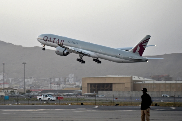 The Qatar Airways plane is the first international commercial flight to depart from Kabul airport since American forces left at the end of August [Wakil Kohsar/AFP]