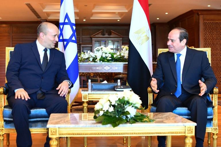 Egyptian President Abdel Fattah al-Sisi (R) meeting with Israeli Prime Minister Naftali Bennett in the Egyptian Red Sea resort town of Sharm El-Sheikh [Egyptian Presidency / AFP]