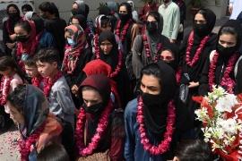 Members of Afghanistan's national women's football team arrive in Lahore [Arif Ali/AFP]
