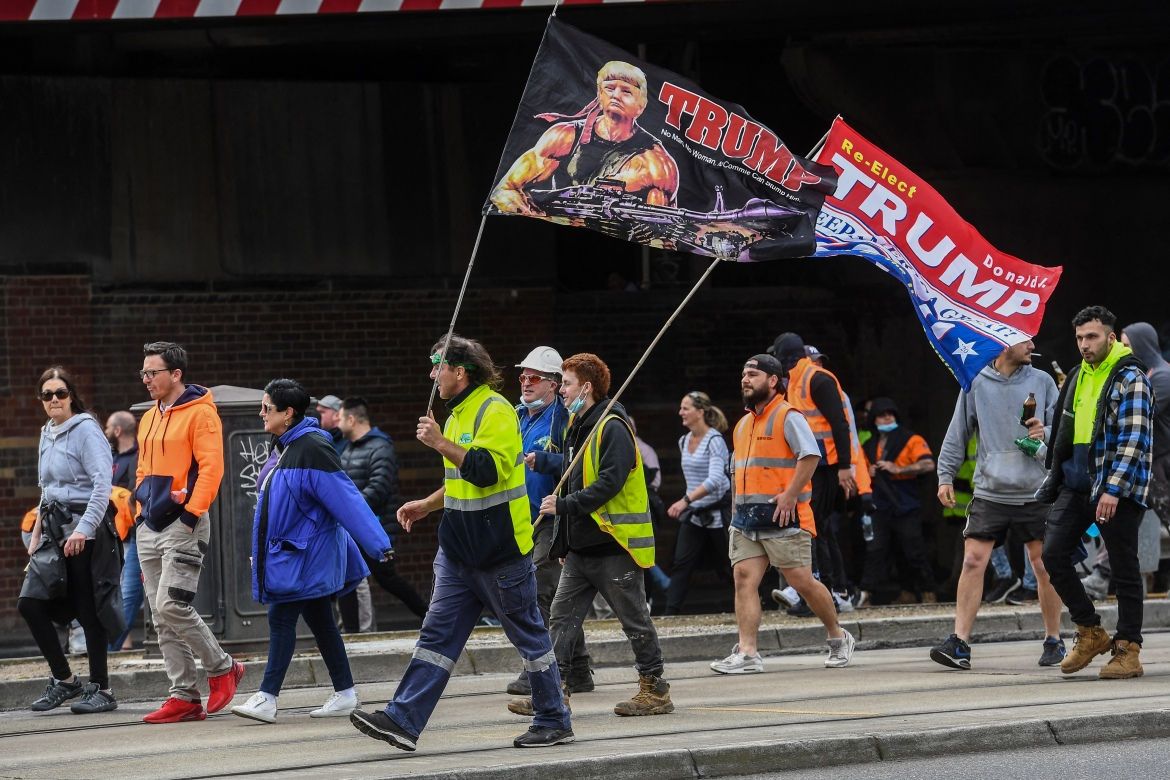 Construction workers attend a protest against COVID-19 regulations in Melbourne, Australia. [William West/AFP]