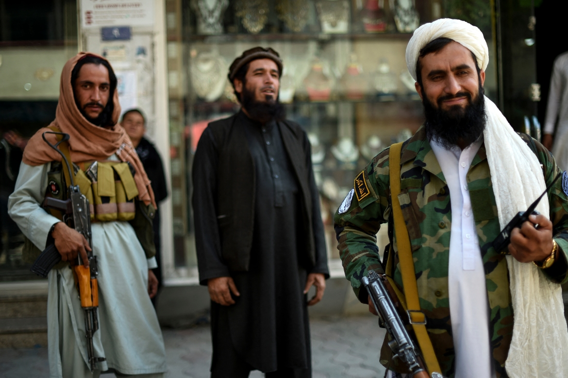 Taliban fighters stand guard on Chicken Street in Kabul. [Wakil Kohsar/AFP]
