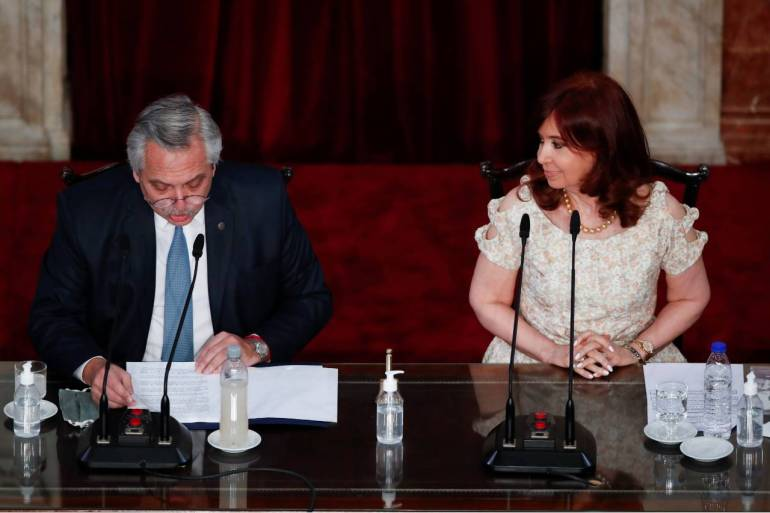 The ruling party's sharp defeat in midterm primary election on Sunday has widened the political divide between President Fernandez and his powerful vice president, Cristina Fernandez de Kirchner [File: Natacha Pisarenko/Reuters]