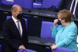 German Chancellor Angela Merkel speaks with Finance Minister Olaf Scholz as she arrives to deliver a government declaration at the lower house of parliament in Berlin, Germany, June 24, 2021 [Christian Mang/Reuters]
