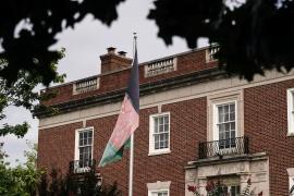 An Afghan flag flutters outside the Afghanistan embassy in Washington, DC [File: Ken Cedeno/Reuters]