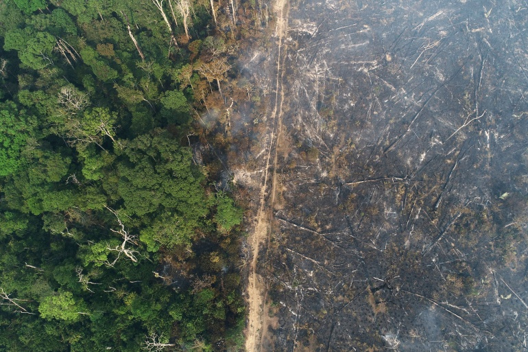 General view of a tract of the Amazon jungle which burns as it is cleared by loggers and farmers near Apui, Amazonas State, Brazil August 11, 2020 [File: Ueslei Marcelino/Reuters]