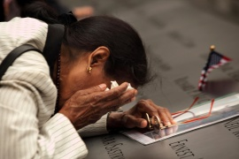 Vasantha Velamuri mourns at the memorial pool at the sight of her husband's name, Sankara Sastry Velamuri, who died in the World Trade Center during the 9/11 attacks. (Reuters)