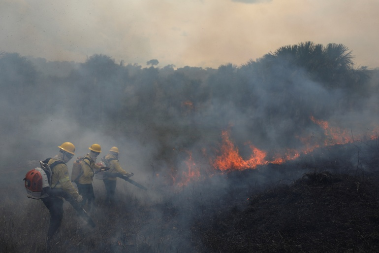 While the Leticia Pact created a protocol on forest fires management in the Amazon, there are few other signs of tangible progress to protect the world's largest rainforest, despite the fanfare and renewed commitments, environmentalists say [File: Bruno Kelly/Reuters]