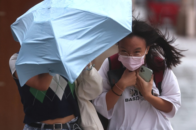 Typhoon Chanthu passed by Taiwan's east coast over the weekend, disrupting transport and causing some power outages, but little damage otherwise. [Ann Wang/ Reuters]