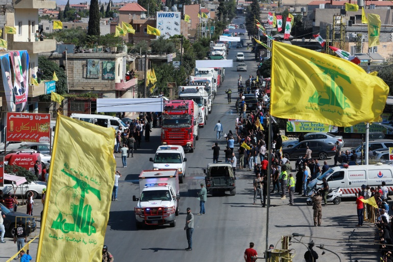 Hezbollah flags flutter as a convoy of tanker trucks carrying Iranian fuel oil arrive at al-Ain village in northeastern Lebanon [Aziz Taher/Reuters]