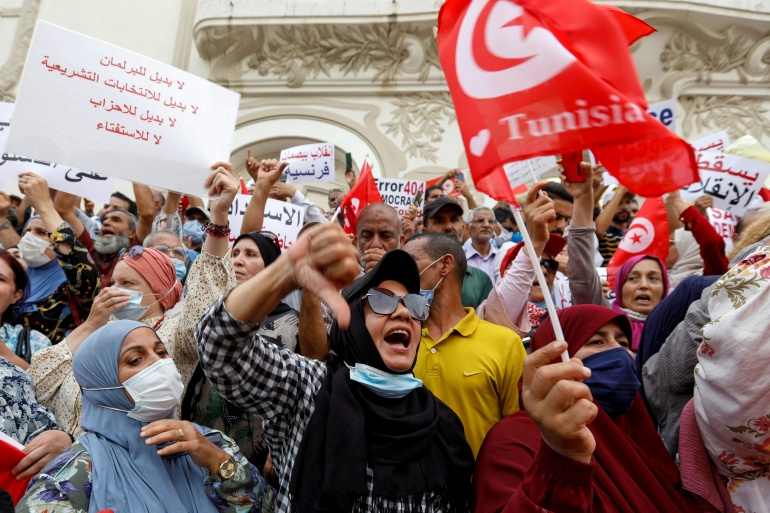 Opponents of Tunisia's President Kais Saied take part in a protest against what they call his coup on July 25 [Zoubeir Souissi/Reuters]