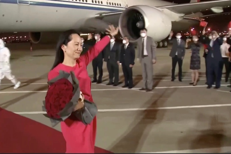 Huawei Technologies Chief Financial Officer Meng Wanzhou waves upon arriving from Canada at the airport in Shenzhen, Guangdong province, China [CCTV via Reuters TV]
