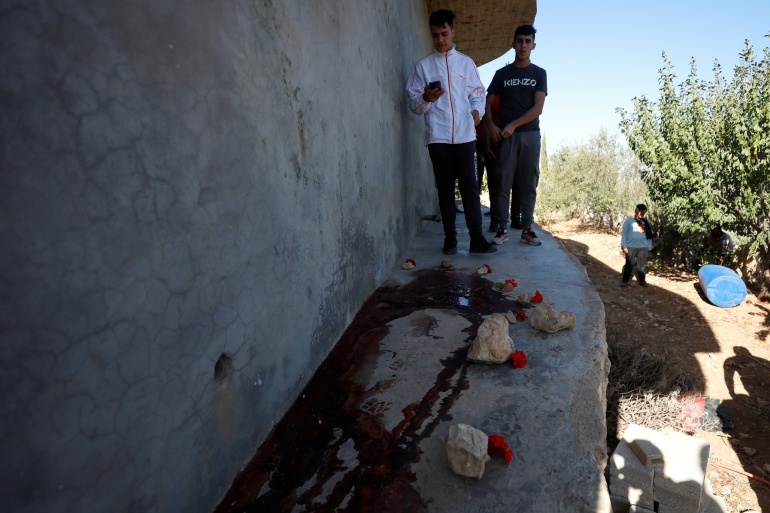 Residents at the scene where three Palestinians were killed by Israeli forces during a raid, in Beit Anan in the Israeli-occupied West Bank, September 26, 2021. REUTERS/Mohamad Torokman