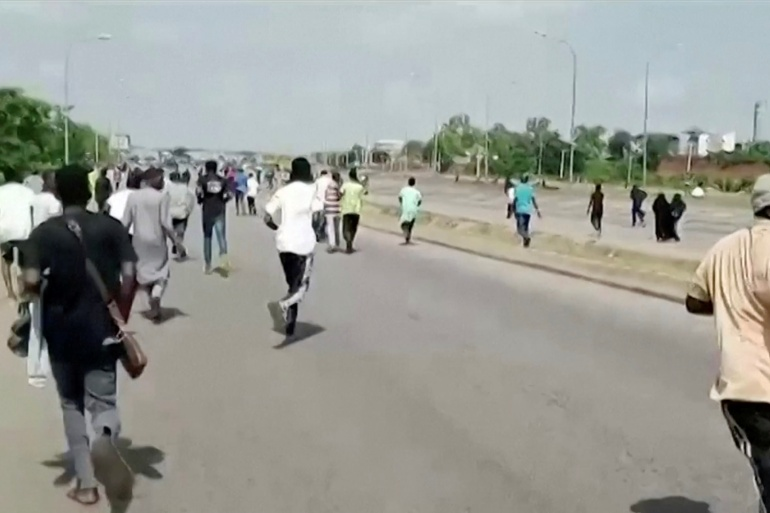 A screen grab shows people running during a protest in Abuja [Courtesy of Islamic Movement In Nigeria/Reuters]
