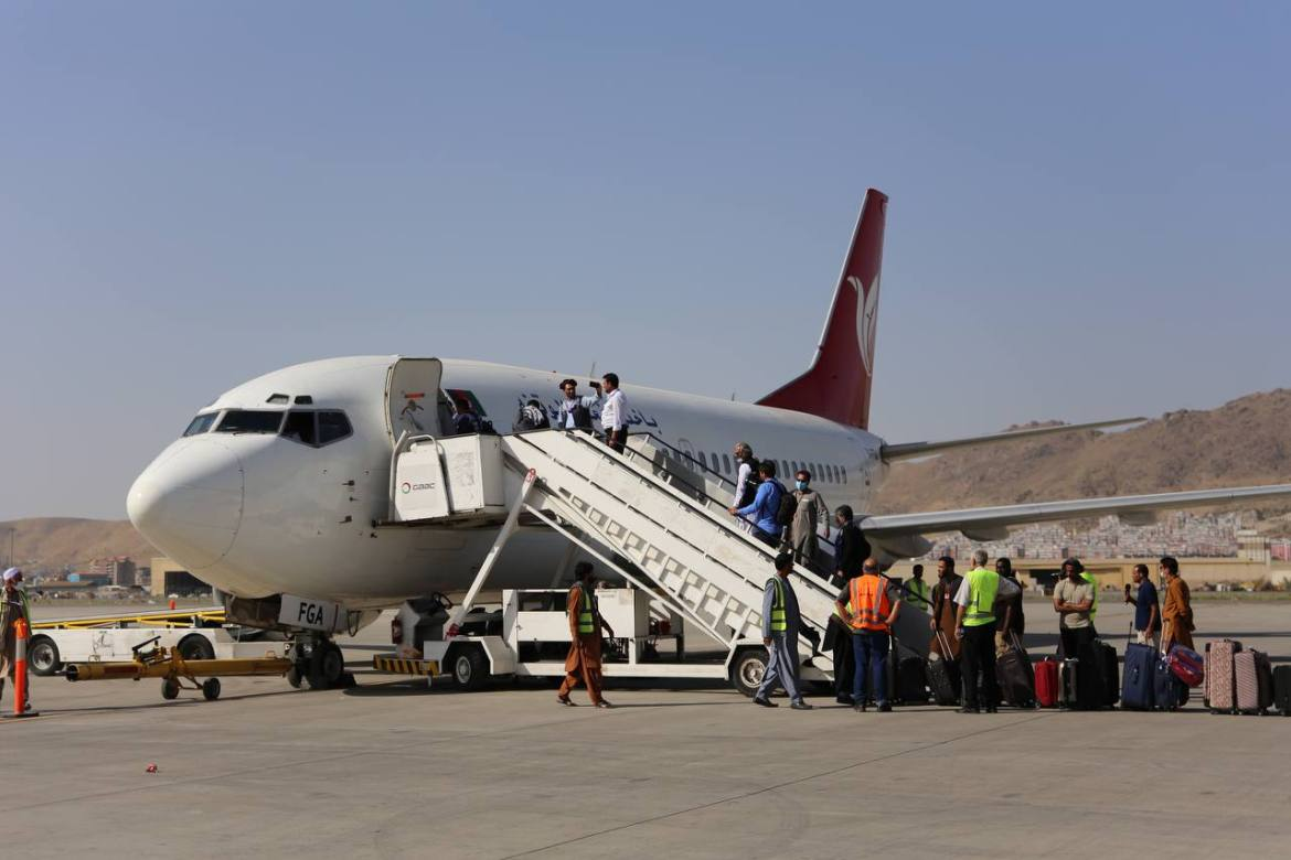 Passengers board the plane for the first domestic flight from Taliban-controlled Kabul airport. [Bilal Güler/Anadolu]