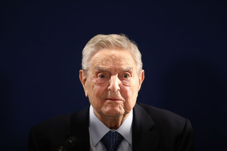 In recent weeks George Soros (pictured) has warned against closer economic ties to President Xi Jinping's China [File: Simon Dawson/Bloomberg]