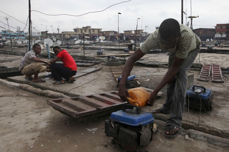 An estimated 22 million small-unit generators are in use by Nigerians, and they plug a vital gap in a country that ranks 171 out of 190 nations in terms of access to electricity, according to the World Bank [File: Sunday Alamba/AP Photo]