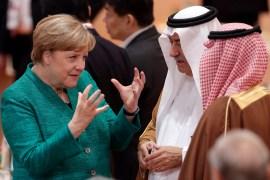German Chancellor Angela Merkel, left, talks to Saudi Arabia's State Minister Ibrahim al-Assaf, prior to a working session at the G-20 summit in Hamburg, northern Germany, Saturday, July 8, 2017 [Michael Sohn/AP]