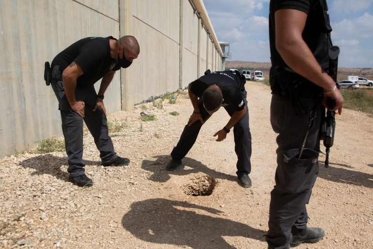 Israeli authorities inspect the scene of a prison escape outside Gilboa prison [Sebastian Scheiner/AP Photo]