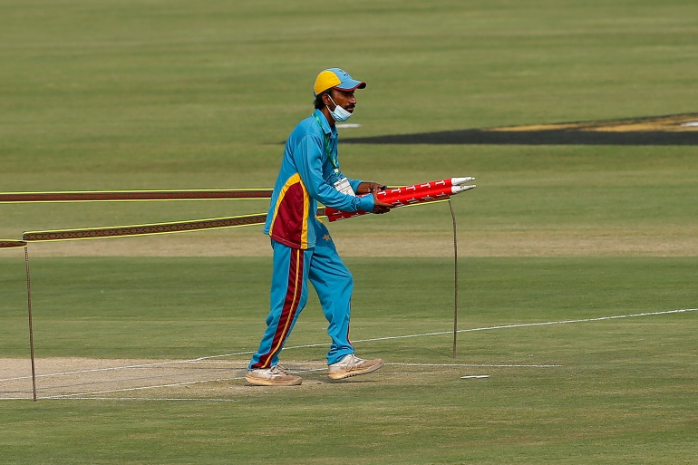 A member of ground staff removes wickets at Pindi Cricket Stadium following the cancellation of the match, in Rawalpindi, Pakistan [Anjum Naveed/AP]
