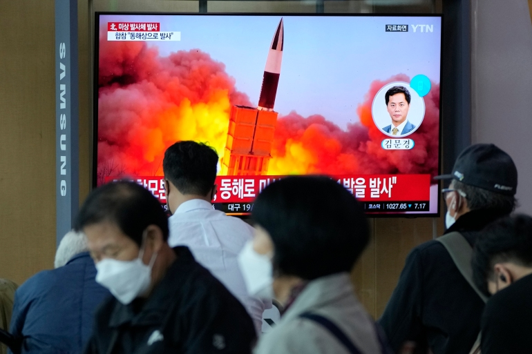 People in Seoul watch television news reports on the latest missile launch using footage from previous weapons tests [Ahn Young-joon/AP Photo]