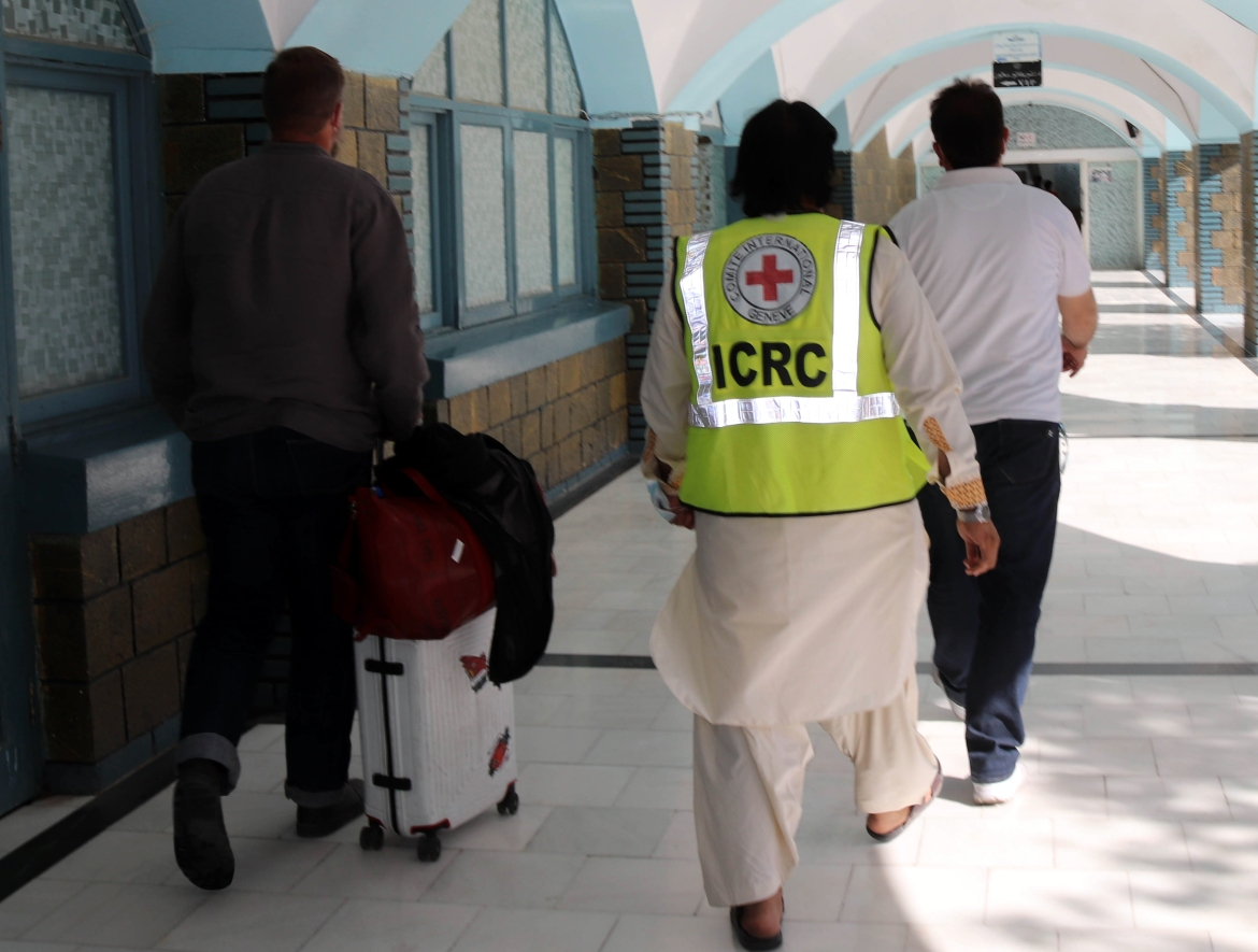 An International Committee of the Red Cross staff arrives at Ahmad Shah Baba International Airport in Kandahar. [EPA]