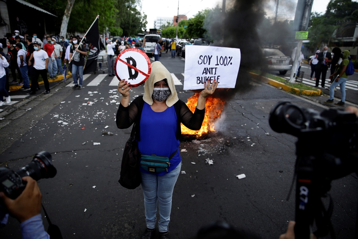 The protests came as El Salvador's government was rushing to iron out technological snags in Bitcoin's first-day rollout. [Rodrigo Sura/EPA]