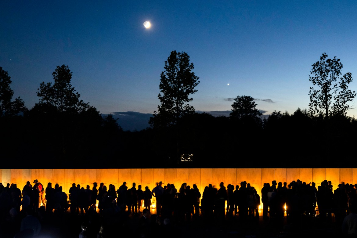 On the eve of the 20th anniversary of 9/11, the Friends of Flight 93 hosted the Luminaria Ceremony at Flight 93 National Memorial Plaza in Shanksville, Pennsylvania. Forty passengers and crew on the flight were killed when they attempted to regain control of the hijacked plane on September 11, 2001.  [Jim Lo Scalzo/EPA]