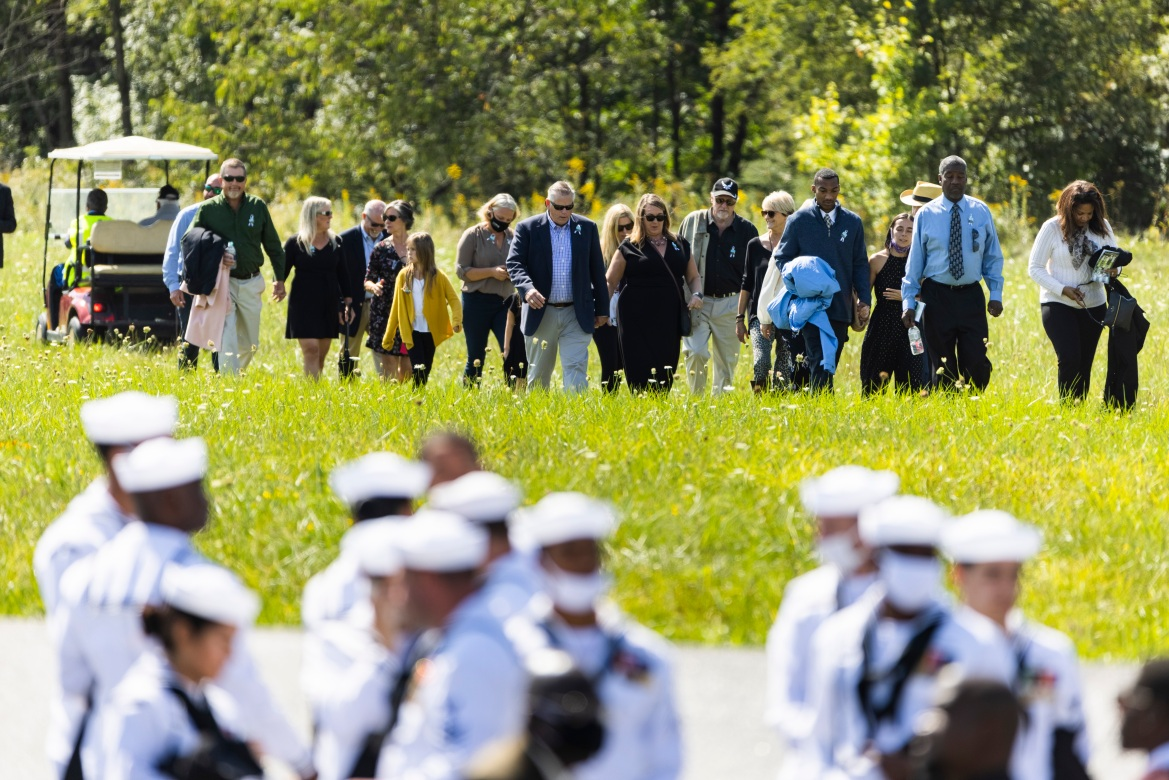 On the 20th anniversary of 9/11, family members of passengers on Flight 93 return from the spot where the plane went down in Shanksville, Pennsylvania. [Jim Lo Scalzo/EPA]