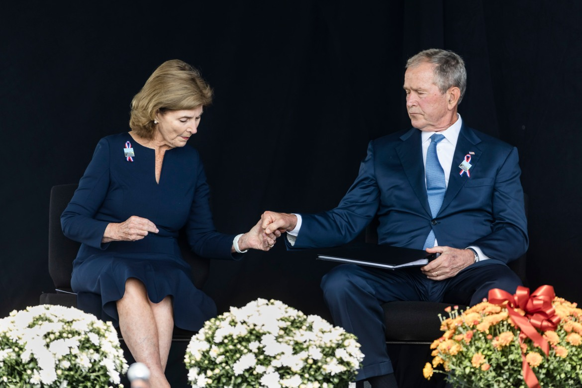 Former US President George W Bush and former First Lady Laura Bush participate in a ceremony to honour the passengers of Flight 93 in Shanksville. [Jim Lo Scalzo/EPA]