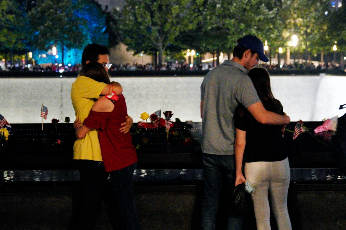 People at the 9/11 Memorial in New York. [Will Oliver/EPA]