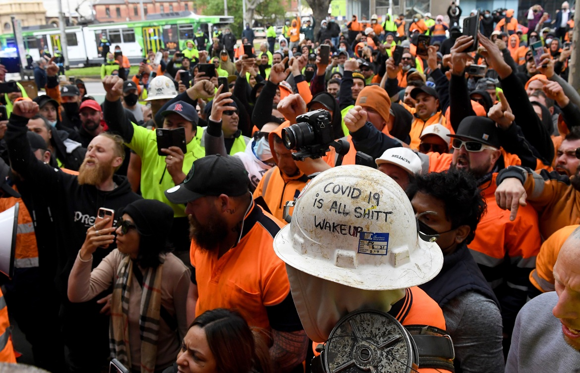 The protest in Melbourne was aimed at a Victoria state government mandate requiring all construction workers to get vaccinated. [James Ross/EPA]