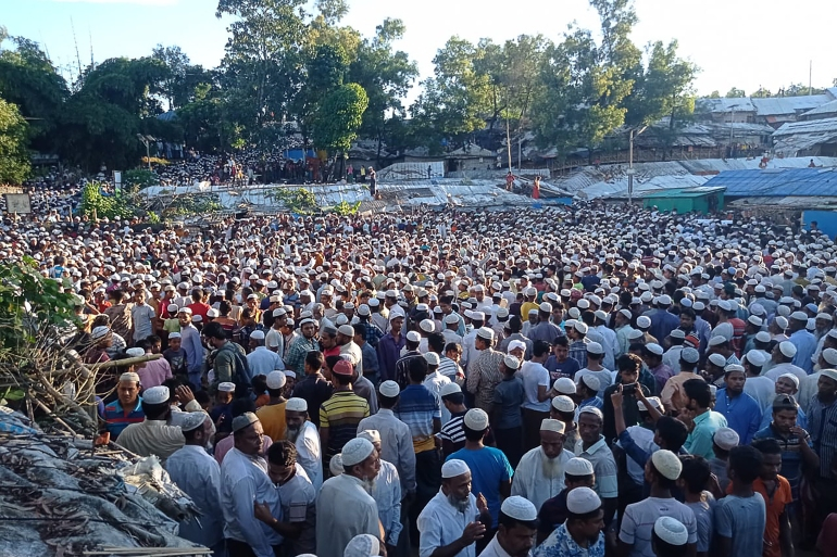 Rohingya refugees offer funeral prayers for Rohingya community leader Mohibullah at Kutupalong refugee camp in Ukhia on September 30, 2021, a day after unidentified assailants gunned him down outside his office [Tanbir Miraj / AFP]