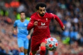 Salah has now scored in seven consecutive games and has nine in as many matches this season [Paul Ellis/AFP]