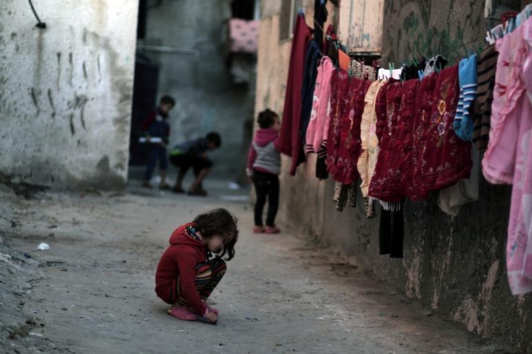 Palestinian children play at the Shati refugee camp in Gaza City [File: Khalil Hamra/AP]